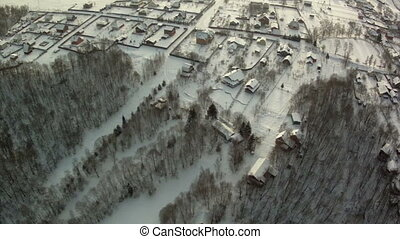 Winter in township. Top view of snowy settlement - Winter in...