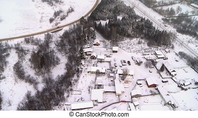 Top view of snow-covered village - Top view of snow-covered...