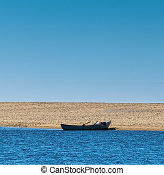 Solo Rowboat Moored on Sandy Beach, copyspace for your idea