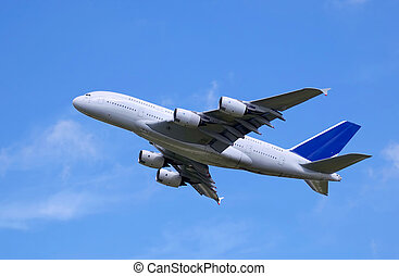 Airliner - white civil airliner climbing into blue sky