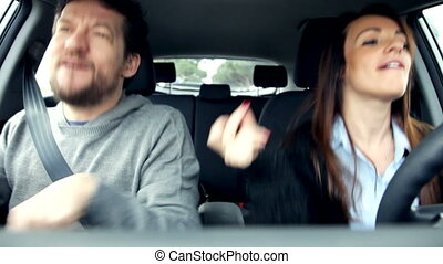 Couple in love dancing in car