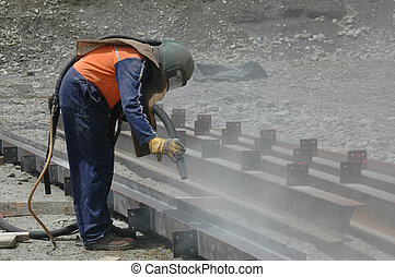 sandblasting 2 - man sandblasting I-beam in preparation for...
