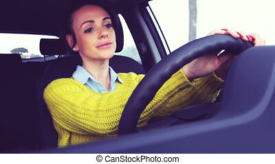 Happy cute woman driving dancing and singing retro style...