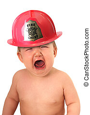 Baby fire fighter - Crying baby wearing a fire fighter hat.