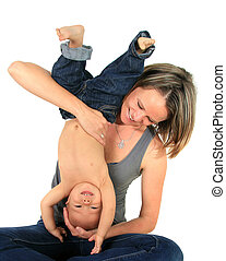 Mother and son - Happy mom and one year old baby boy playful...