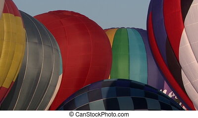 Domes of hot air balloons on sky background, close-up
