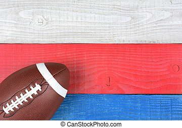Football on Red, White, Blue Table - High angle shot of an...