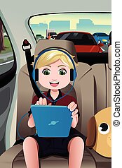 Kid riding a car using a tablet