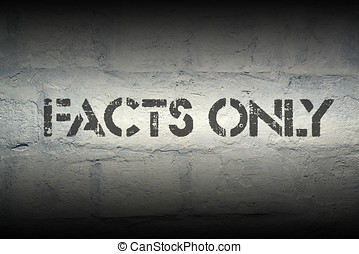 facts only stencil print on the grunge white brick wall