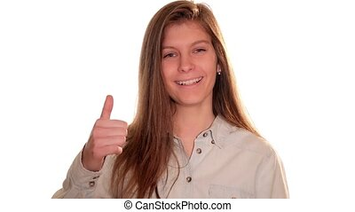 cute girl doing thumb-up sign over - Portrait of...