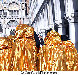 Golden costumes for the Carnival in Venice Italy
