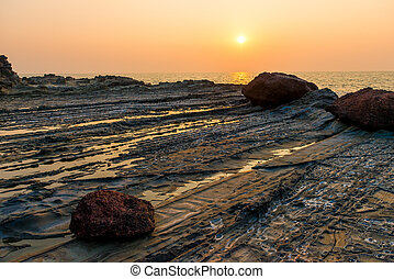 beautiful sunset over the sea and rocky