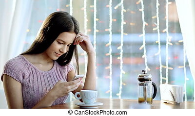 Phone Message - Close up of teenage girl texting via...