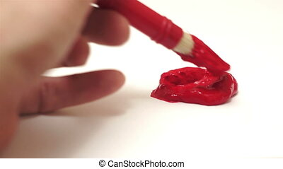Painting Red Art Brush Mixing - A close up shot of a man...