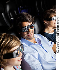 Family Watching 3D Movie In Theater