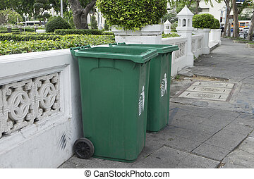 Row of green and clean rubbish bins on the street