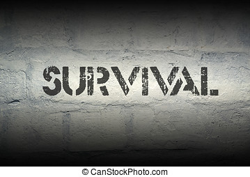 survival stencil print on the grunge white brick wall