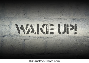 wake up exclamation stencil print on the grunge white brick...