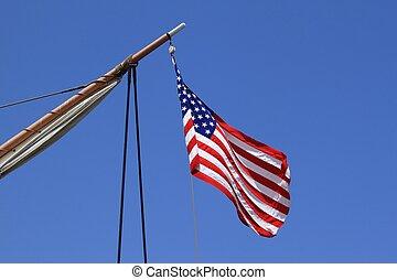 USA flag sail ship - USA flag on an old sail ship with blue...