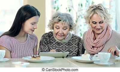 Technological Generations - Portrait of three women of...