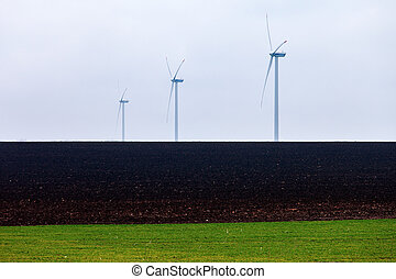Wind Power on the field with gree grass