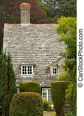 rural cottage - partial view of an english rural cottage...