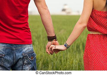 segurando, mãos, par,