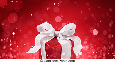 christmas gift against red bokeh lights background