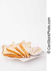 bread sandwich with tuna fish on white paper background