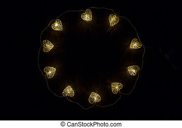 Big circle from small enlightened hearts, christmas or...