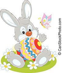 Easter Bunny - Little rabbit sitting with a big decorated...