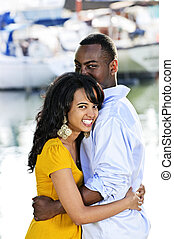 Happy couple embracing - Young romantic couple hugging and...