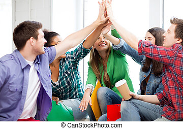 students giving high five at school - education concept -...
