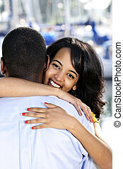 Happy woman hugging man - Portrait of beautiful young woman...