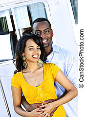 Happy couple in front of yacht - Portrait of young romantic...