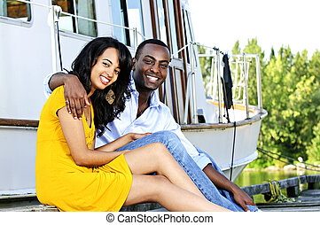 Happy couple in front of yacht - Young romantic couple...