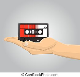 Hand holding an audio casette
