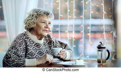 Alone with her Thoughts - Close up of senior woman having a...