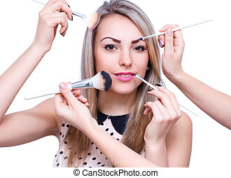 Make up woman with many hands. Makeup brushes. Isolated on white