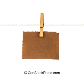 Old blank sheet of paper hanging on a rope with clothespin