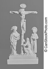 Sculptural religious crucifixion scene on a gray background