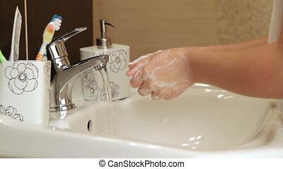 Child washing her hands