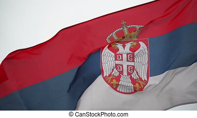 Serbian National Flag flapping in the strong wing, waving...