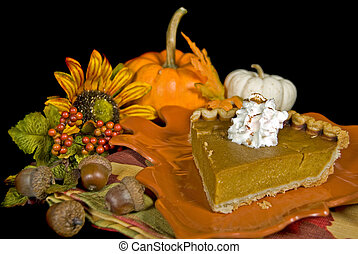 Thanksgiving Tradition - Slice of pumpkin pie with pumpkins...