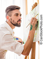 Artist - Highly gifted painter is painting his picture with...