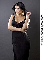 classy woman - pretty brunette woman wearing black dress on...