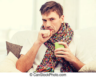 ill man with flu at home - healthcare and medicine concept -...
