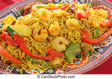 Chinese food of curry prawns, vegetables and noodles.