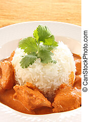 Butter chicken over rice - Indian butter chicken over rice.