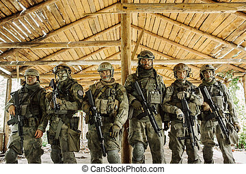 group of soldiers standing and looking at the camera - group...
